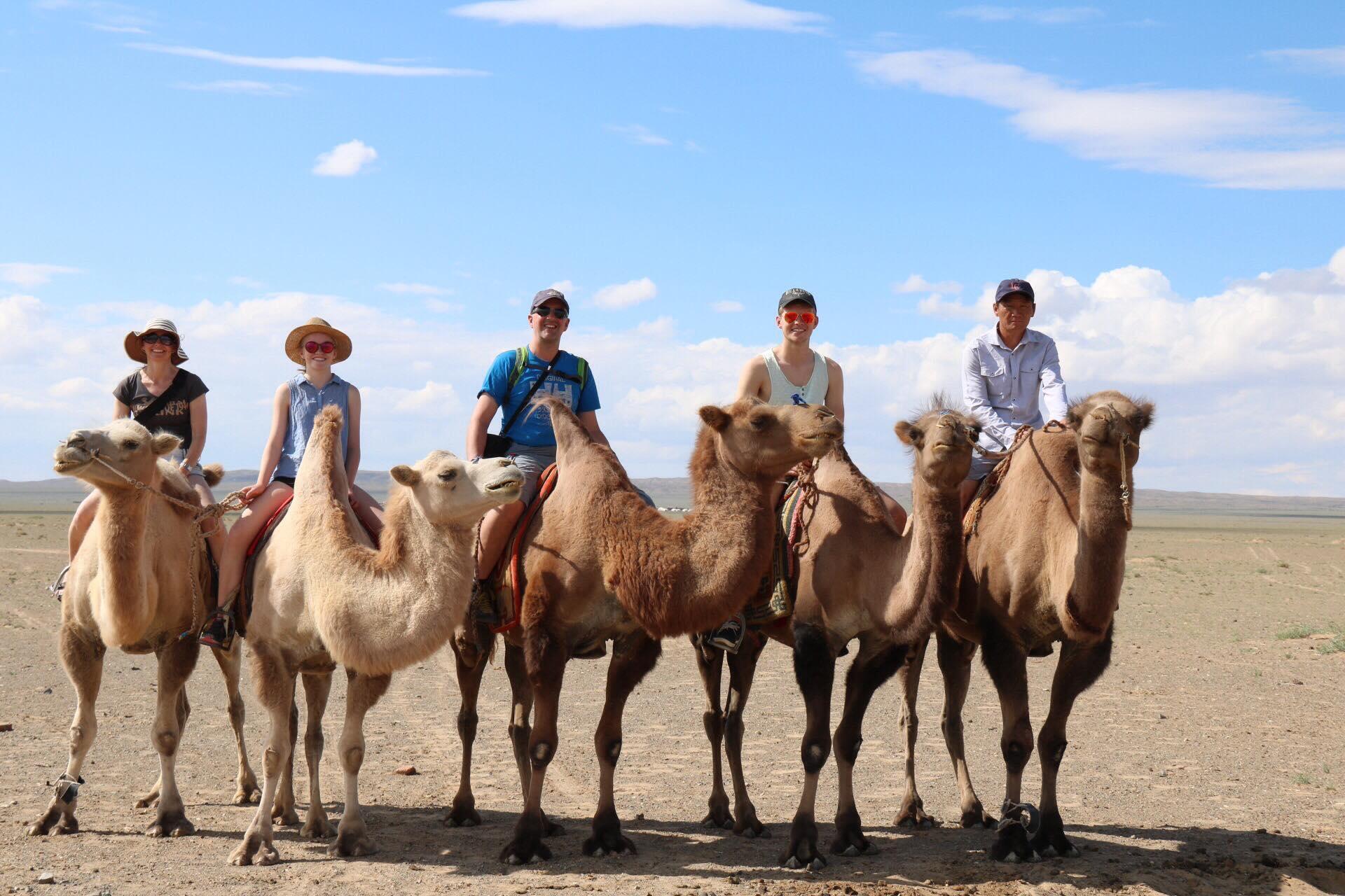 camel riding in Gobi
